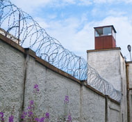 Jail wall with barbwire